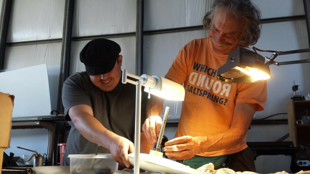 NIcolas Wainwright (left) and Mark Coulter rebuilding the Microship Spinfin pedal drive unit