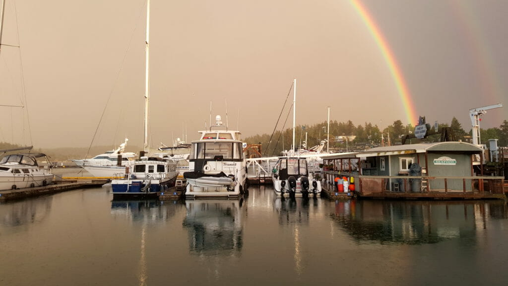 A full-arc double rainbow on May 8 was a photographic treat... here's the view off my stern.