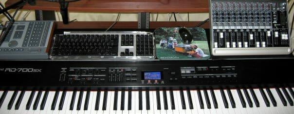 Keyboard shelf loaded with gear