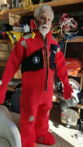 Dick modeling one of the two immersion suits included with the boat... like most of the safety equipment, something we hope is never needed!